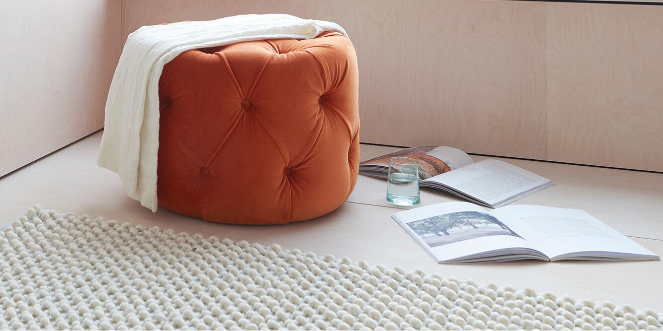 Gumdrop upholstered buttoned footstool