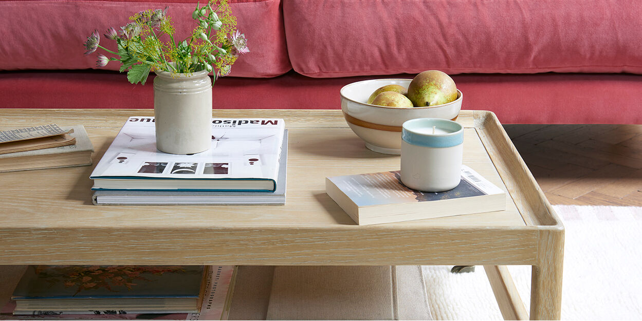 Slingshot coffee table with storage shelf