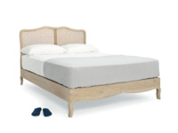 Vintage French wooden Margot bed with rattan headboard that has a lovely antique natural finish