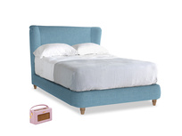 Double Hugger Bed in Moroccan blue clever woolly fabric
