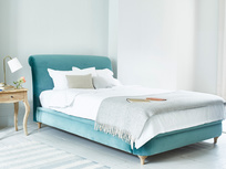 Dumpling upholstered curved bed