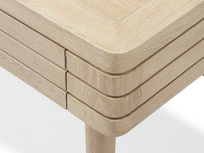 Clever Bubba blonde oak writing desk corner detail