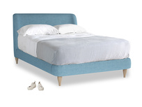 Double Puffball Bed in Moroccan blue clever woolly fabric
