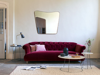 Big brass mirror and Dixie elegant button back sofa
