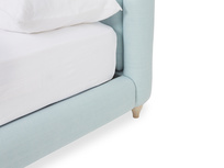 Cushdie upholstered fabric headboard front corner