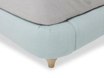 Cushdie padded fabric headboard bottom corner