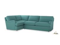 Large left hand Jonesy Corner Sofa Bed in Peacock brushed cotton