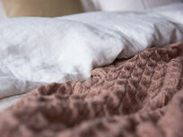 Chunky Knit throw in Rusted Rose bed close