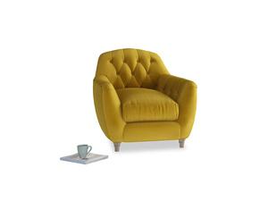 Butterbump Armchair in Burnt yellow vintage velvet