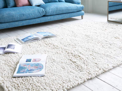 Shaggy rug is a handmade knitted floor rug