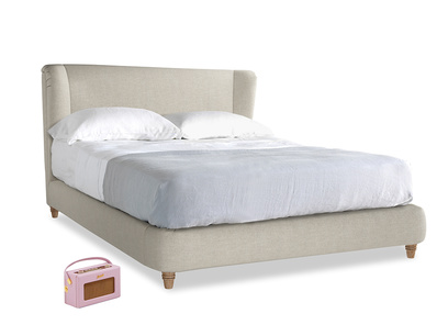 Hugger wing back upholstered bed