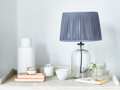 Apothecary glass base pleated shade table lamp