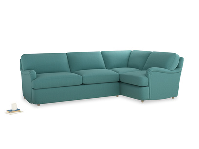 Large right hand Jonesy Corner Sofa Bed in Peacock brushed cotton