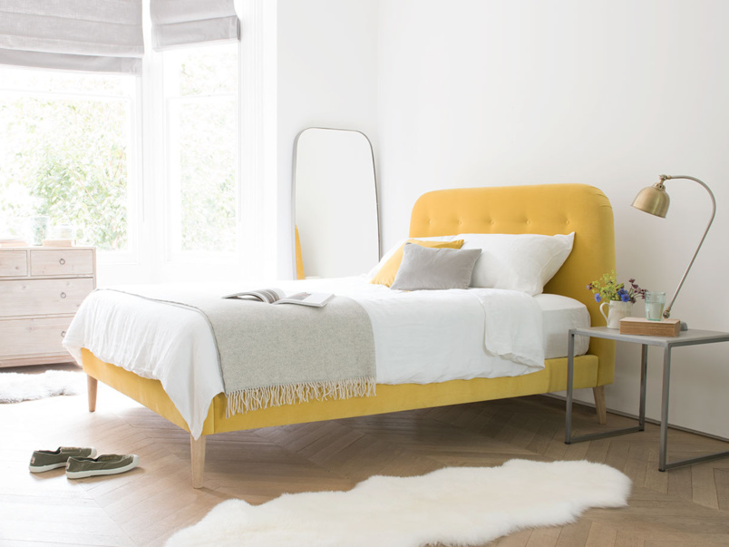 Napper upholstered yellow retro bed