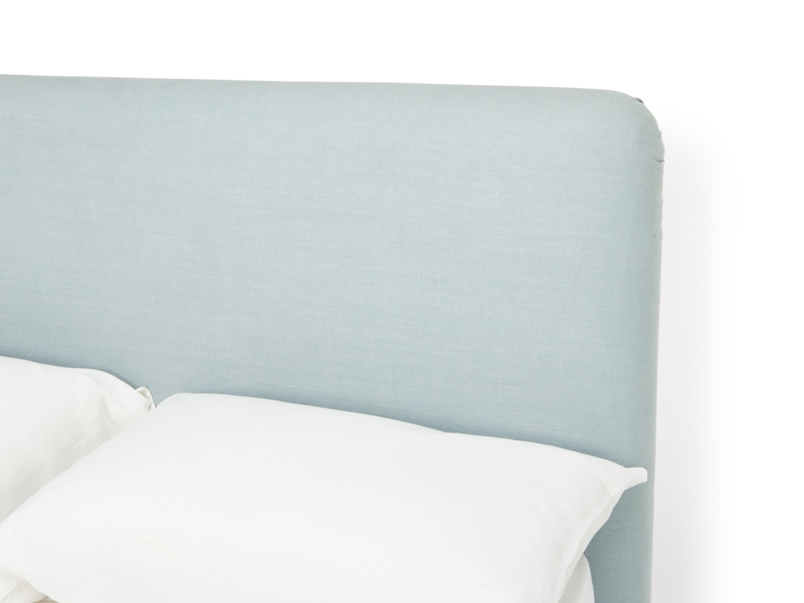 Luxury upholstered headboard on modern Ruffle bed