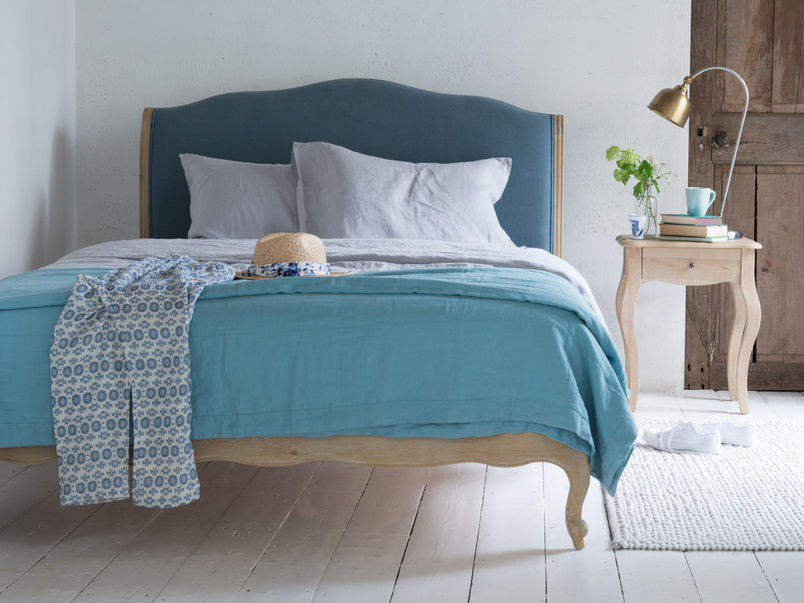 Wooden Coco French inspired style bed upholstered in Dusk vintage linen