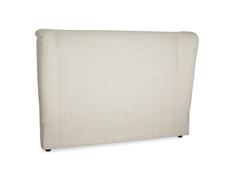 Hugger upholstered wing back headboard