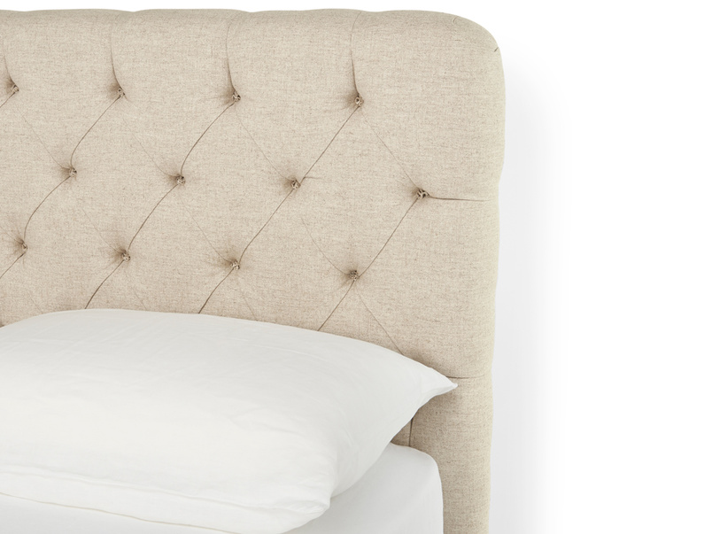 Curved and buttoned Billow handmade upholstered headboard