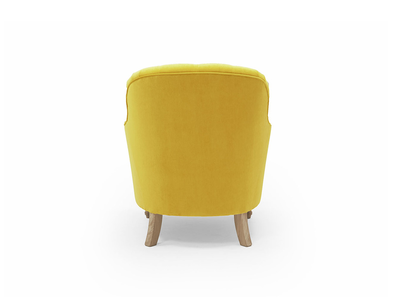 Reader upholstered button back armchair