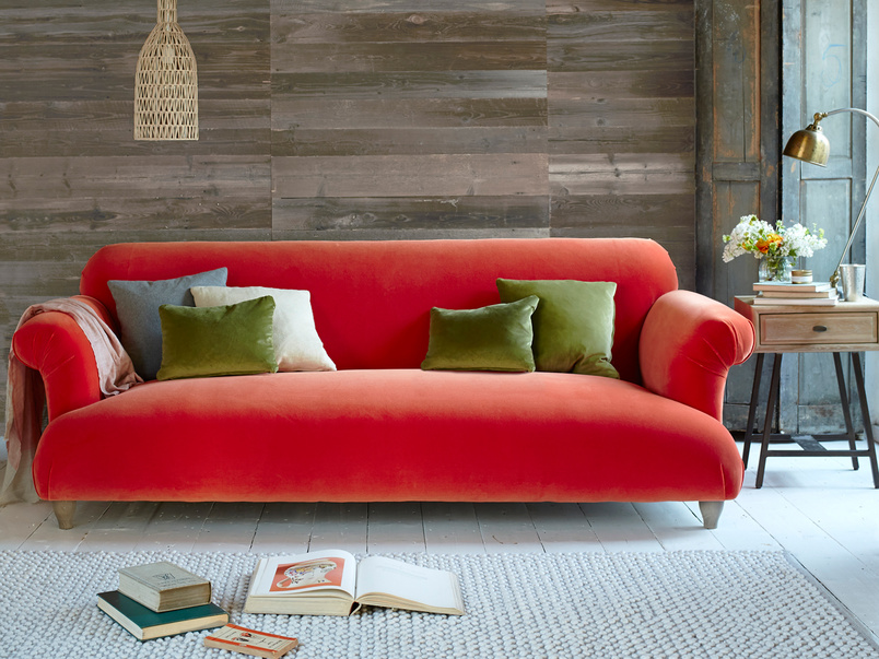 Modern Soufflé sofa with lovely curved details in Slate clever velvet