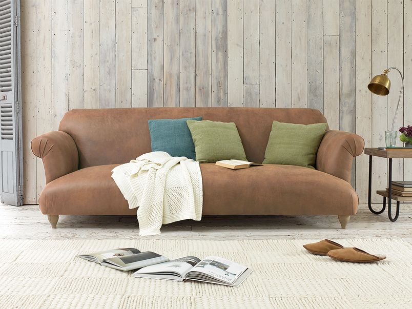 Soufflé sofa in Walnut beaten leather is a modern style extra comfy sofa with rounded corners
