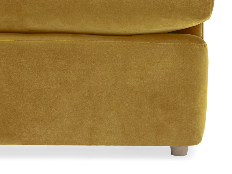Truffle upholstered sofa bed leg detail