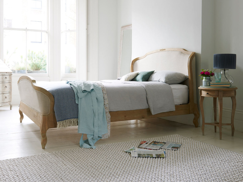 Upholstered French antique style Joëlle sleigh bed