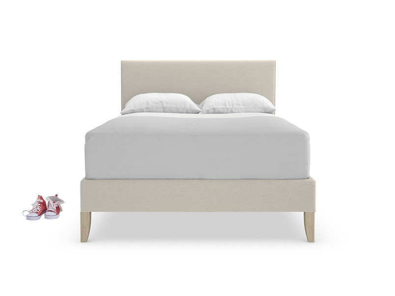 Upholstered luxury Piper bed with beautiful piping detail on headboard