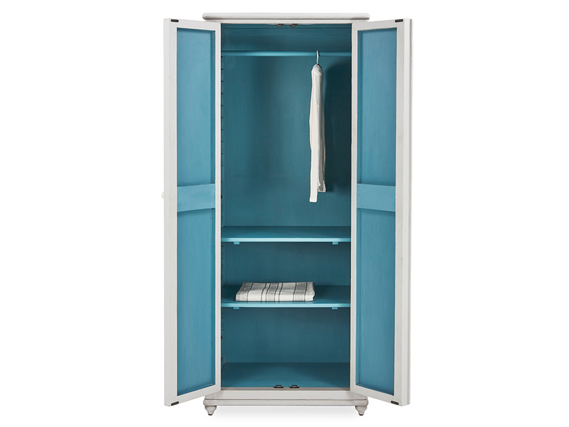 Grand popinjay blue and white wardrobe inside detail with prop