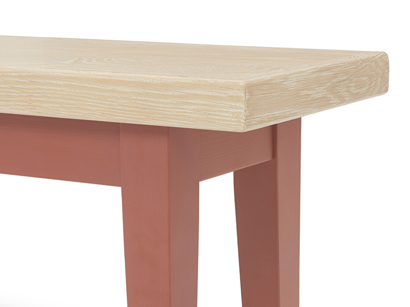 Plonk in earthy red dining bench leg detail
