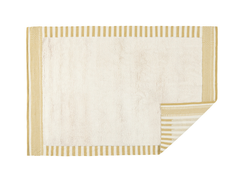 Loom squishy rug in Burnt Yellow