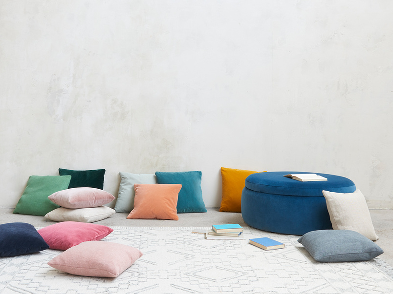 Scatter comfy colourful cushions