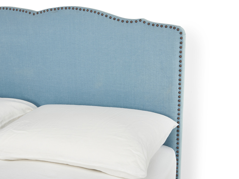 Lovely curved detail on French style handmade Marie headboard upholstered with studding