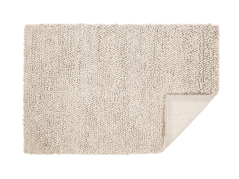 Shaggy rug is a handmade small stylish knitted floor rug