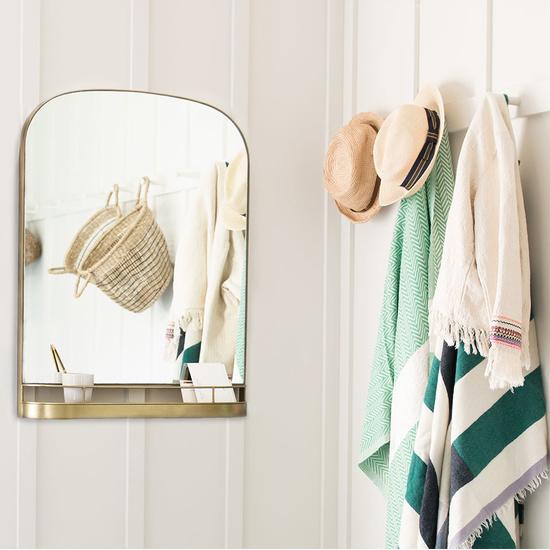 Stellina mirror with brass frame and shelf